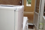 original-to-house-wooden-lean-to-converted-to-weatherproof-utility-room-after-2