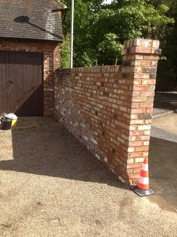 rebuilt-using-reclaimed-bricks-and-lime-mortar-the-wall-was-grade-2-listed-3