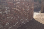 rebuilt-using-reclaimed-bricks-and-lime-mortar-the-wall-was-grade-2-listed-4